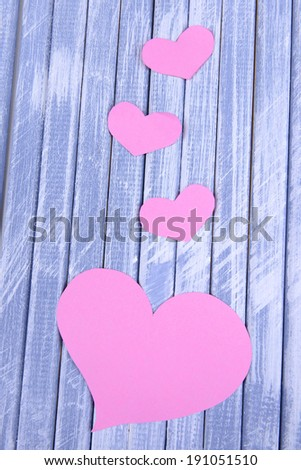 Paper hearts on wooden  background #191051510