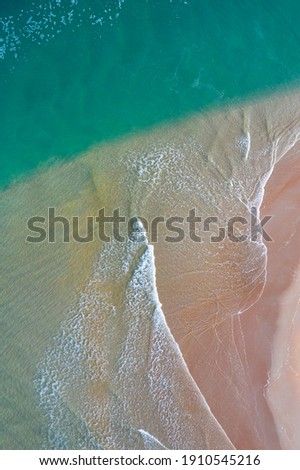 Aerial view of Rabia beach and Capitan creek and marshes with low tide in Oyambre Natural Park of San Vicente de la Barquera village by the Cantabrian Sea in Cantabria of Spain, Europe Royalty-Free Stock Photo #1910545216