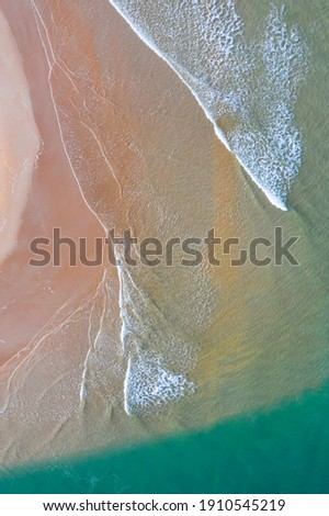 Aerial view of Rabia beach and Capitan creek and marshes with low tide in Oyambre Natural Park of San Vicente de la Barquera village by the Cantabrian Sea in Cantabria of Spain, Europe Royalty-Free Stock Photo #1910545219