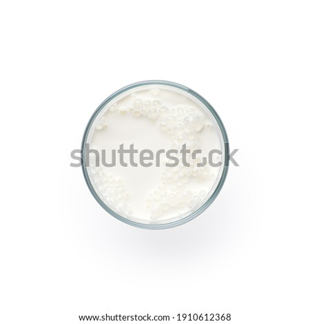 Glass of milk isolated on white background, top view Royalty-Free Stock Photo #1910612368