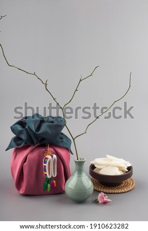 Korean traditional wrapping cloth gift box on the gray background Royalty-Free Stock Photo #1910623282