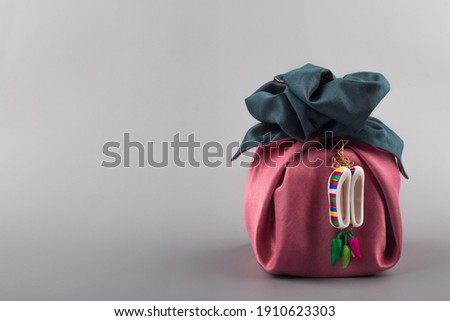 Korean traditional wrapping cloth gift box on the gray background Royalty-Free Stock Photo #1910623303