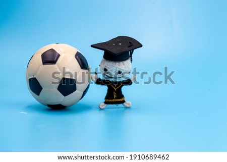 Soccer graduation with soccer ball and hat on blue background
