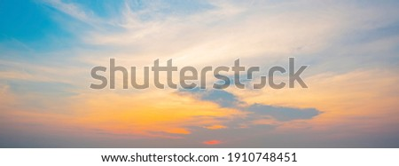 The morning sky looked like a bright golden sky. The sunrise is decorated with clouds in various shapes. Looks beautiful. Royalty-Free Stock Photo #1910748451