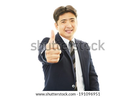 Smiling businessman with thumbs up #191096951
