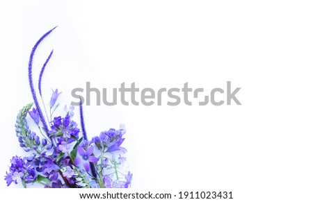 A bouquet of lilac flowers on a white background. Spring flower arrangement. Background for greeting cards, invitations. Royalty-Free Stock Photo #1911023431