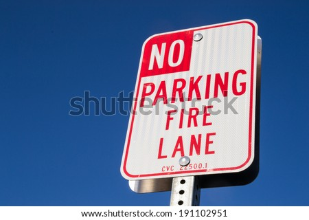 "The ""No parking fire lane"" sign."