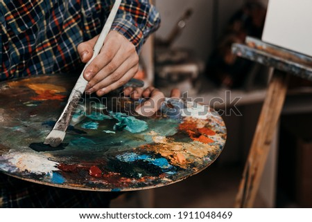 The artist in the art class of the school as a drawing course. Discounts on products for artists. Easel for still lifes. Royalty-Free Stock Photo #1911048469