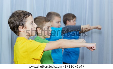 Boys in colorful t-shirts make a punch Royalty-Free Stock Photo #1911076549