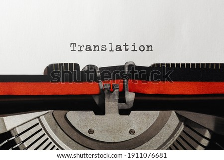 Text Translation typed on retro typewriter