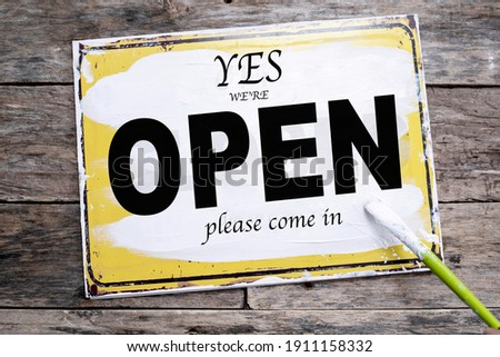we are reopening sign  paint