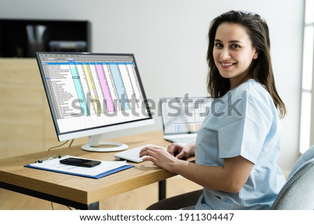 Medical Bill Codes And Spreadsheet Data. Business Analyst Woman Royalty-Free Stock Photo #1911304447