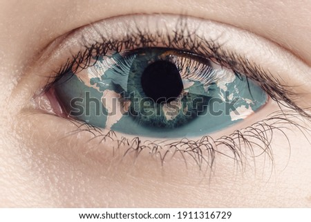 Earth continents painted on eye iris, concept save the planet. Image of earth painted on face skin. Creative composition of eye and planet earth. Elements of this image furnished by NASA . Royalty-Free Stock Photo #1911316729