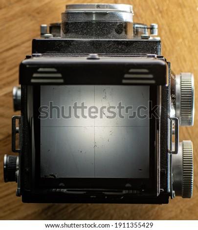 top shot of medium format camera focussing screen or waist level finder, blend in your photo via blend mode.
