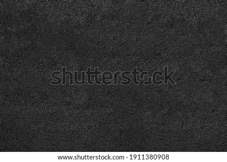 Asphalt texture - top view and close-up of a fragment of an old asphalt road Royalty-Free Stock Photo #1911380908