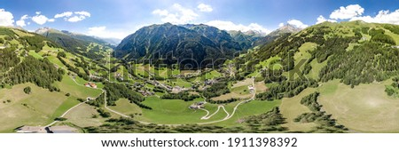 360 Aerial panoramic drone shot of Helligenblutt village in Grossglockner mountain valley in Austria