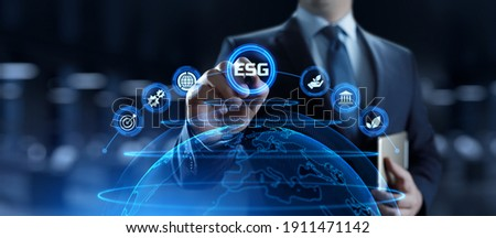 ESG environmental social governance business strategy investing concept. Businessman pressing button on screen. Royalty-Free Stock Photo #1911471142