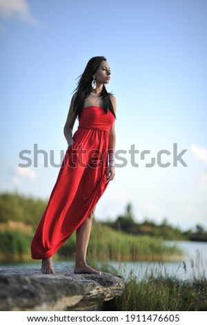 lifestyle photo of woman with perfect hair.walking alone at the beach.Sensual young girl relaxing.Colorful filter.glam style,teen trend outfit, positive mood,smiling,amazing model girl,long hair