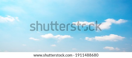 Air clouds in the blue sky.blue backdrop in the air. abstract style for text, design, fashion, agencies, websites, bloggers, publications, online marketers, brand, pattern, model, animation, Royalty-Free Stock Photo #1911488680