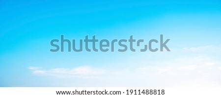 Blue sky and white clouds floated in the sky on a clear day with warm sunshine combined with cool breeze blowing against the body resulting in a miraculous refreshing like paradise Royalty-Free Stock Photo #1911488818