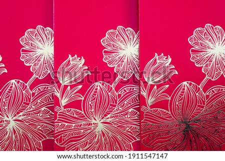 Selective focus of 3 red packets money with flower pattern for Chinese New Year. Royalty-Free Stock Photo #1911547147