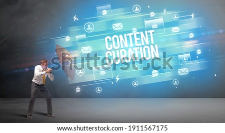 Handsome businessman defending with umbrella from CONTENT CURATION inscription, new age media concept
