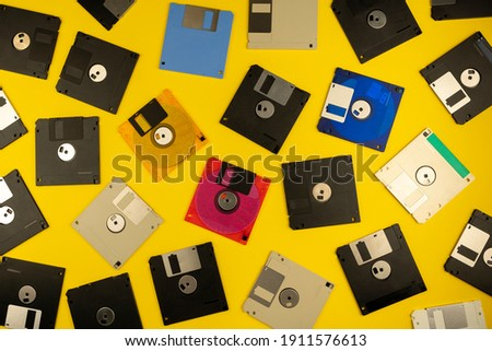 Floppy disk 3.5 inch. The diskettes 3 2 are a technology icons of de decade of 80s. Retro, vintage and colourful computer diskette. Yellow background.