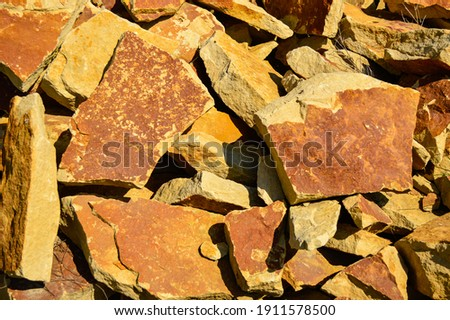 Large pile of sandstone stones close up Royalty-Free Stock Photo #1911578500