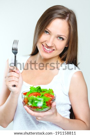 attractive woman eating salad with vegetables. healthy food. #191158811
