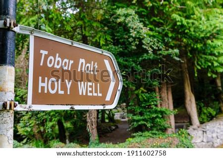 "Bilingual English and Gaelic sign for ""Tobar Nalt"" (tr: Holy Well), County Sligo, Ireland Royalty-Free Stock Photo #1911602758"