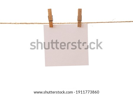 Empty color paper sheets for notes, frames that hang on a rope with clothespins and isolated on white. Blank cards on rope mockup template. Royalty-Free Stock Photo #1911773860