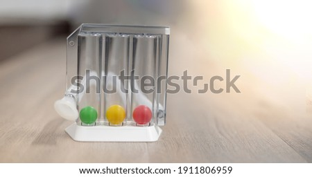 The Tri-ball incentive spirometry is medical equipment for elderly or patient with post operation. For Lungs function testing and Pulmonary test. Royalty-Free Stock Photo #1911806959