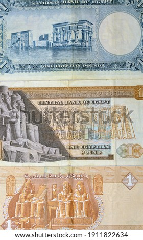 collection of an Egyptian one pound 1967 banknote , 1973 banknote and 2016 banknote . old Egyptian money . Egyptian currency Royalty-Free Stock Photo #1911822634