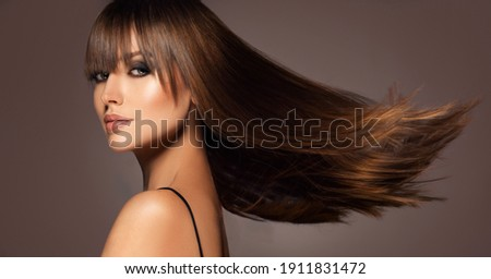 Beautiful model woman with shiny  and straight long hair. Keratin  straightening. Treatment, care and spa procedures. Beauty  girl smooth hairstyle Royalty-Free Stock Photo #1911831472