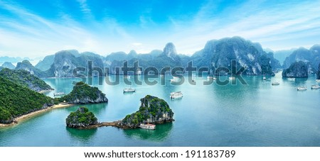 Tourist junks floating among limestone rocks at early morning in Ha Long Bay, South China Sea, Vietnam, Southeast Asia. Five images panorama Royalty-Free Stock Photo #191183789