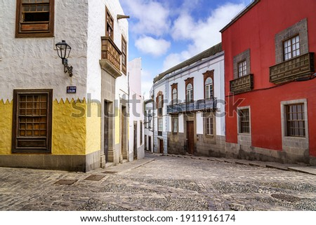 street with old, picturesque and charming houses in bright colors in the city of Las Palmas de Gran Canaria. Canary Islands. Spain. Royalty-Free Stock Photo #1911916174