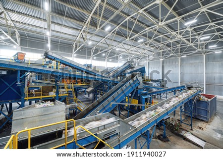 A modern plant for sorting and recycling household waste and waste. Large industrial complex of conveyors, bunkers. Royalty-Free Stock Photo #1911940027