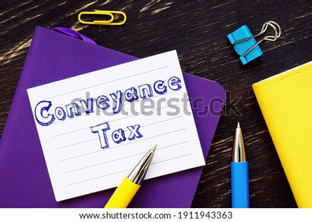 Conveyance Tax inscription on the piece of paper. Royalty-Free Stock Photo #1911943363