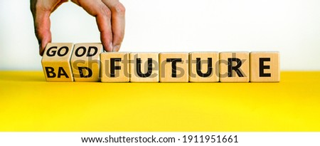 Good or bad future symbol. Businessman turns wooden cubes and changes words 'bad future' to 'good future'. Beautiful white background, copy space. Business and bad or good future concept.