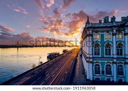 Saint-Petersburg, Russia. Dawn over the Palace embankment. Sunrise over the Hermitage. Early morning in Saint-Petersburg. Sunrise over the Neva river. Cities of Russia. Early morning in a big city. Royalty-Free Stock Photo #1911963058