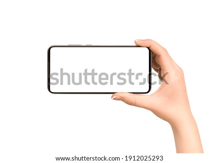 female hand holds a smart phone. front view on isolated white background Royalty-Free Stock Photo #1912025293