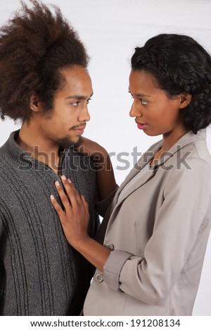 Romantic black couple, man  and woman, with eye contact and affectionately touching #191208134