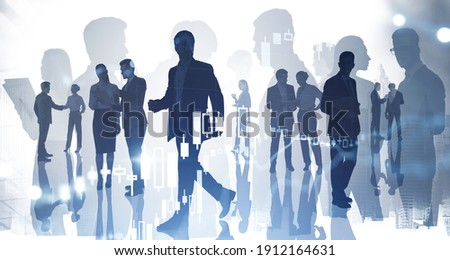 Silhouettes of businesspeople working and researching the analytics to predict stock market behaviour. Forex chart on background. Double exposure