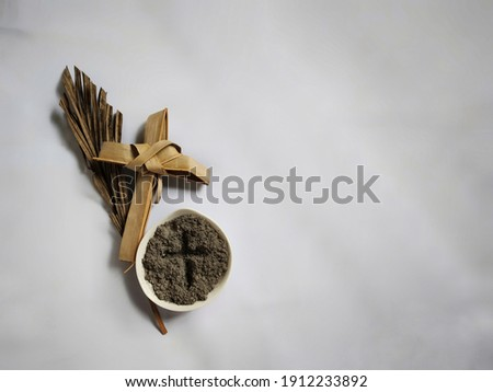 Lent Season,Holy Week and Good Friday Concepts - photo of bowl of ash with cross made of palm leave background. Stock photo.