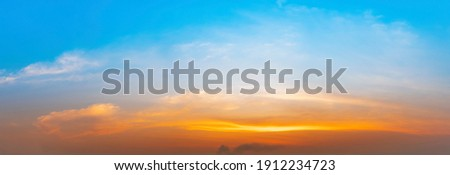 The morning sky looked like a bright golden sky. The sunrise is decorated with clouds in various shapes. Looks beautiful. Royalty-Free Stock Photo #1912234723