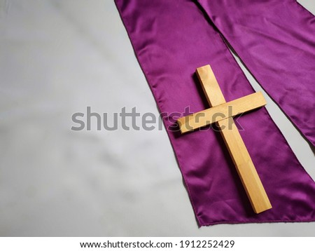 Lent Season,Holy Week and Good Friday concepts - image of wooden cross in vintage background. Stock photo.
