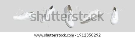 Flying white leather womens sneakers isolated on gray background, different kind. Fashionable stylish sports casual shoes. Creative minimalistic layout with footwear. Advertising for shoe store, blog Royalty-Free Stock Photo #1912350292