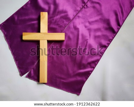Lent Season,Holy Week and Good Friday concepts - photo of wooden cross in vintage background. Stock photo.