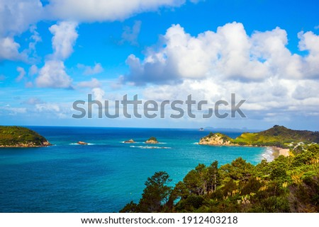 The concept of active, exotic, ecological and photo tourism. Incredible clouds over the evening tide. Pacific Ocean, New Zealand. Road to the Cathedral Cove on the North Island