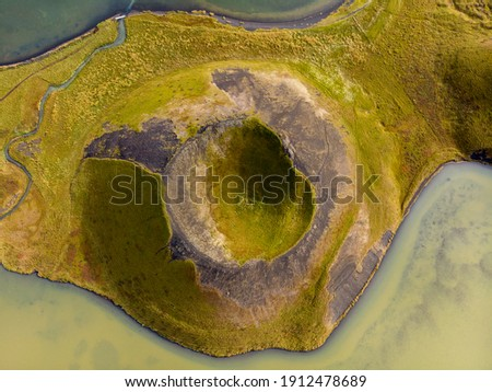 One of the unique Phenomenon Pseudocraters at the amazing Mývatn Area in North-Iceland. Top view from drone. Royalty-Free Stock Photo #1912478689